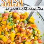 overhead photo of mango avocado salsa in clear glass bowl with text overlay