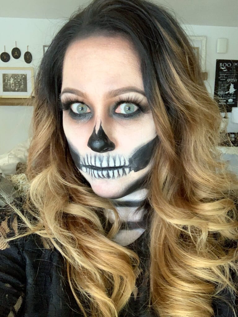 close up photo of woman with skeleton face makeup