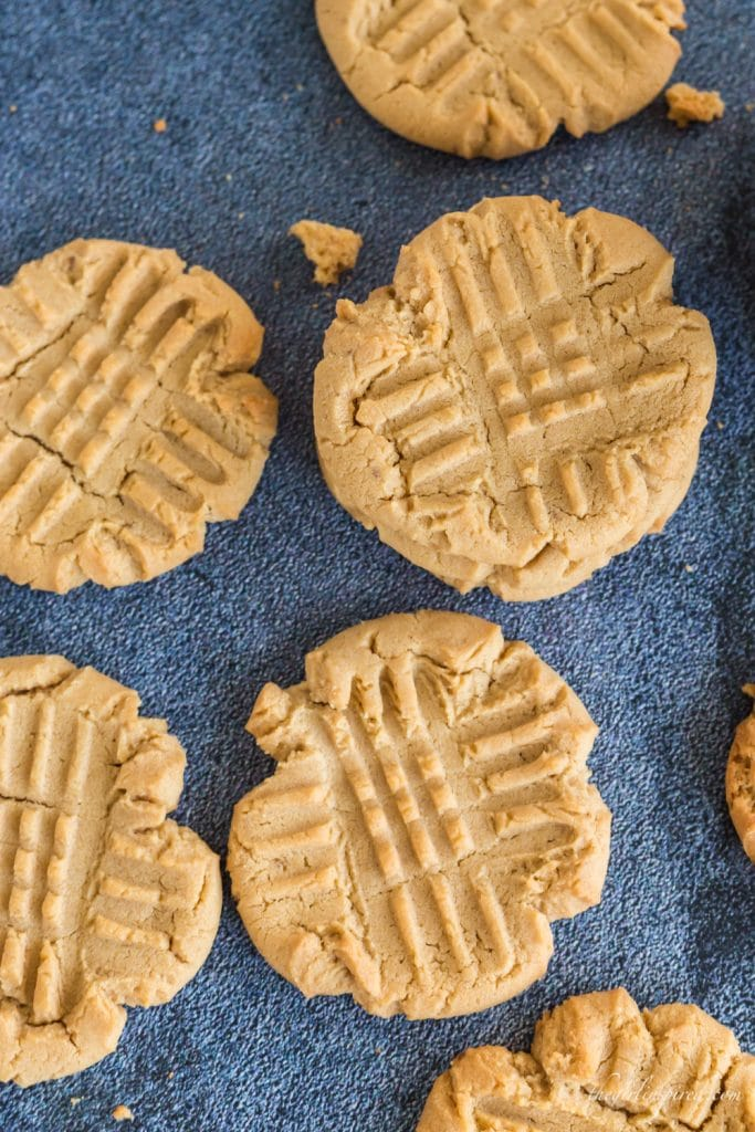 overhead view of peanut butter cookies on blue background