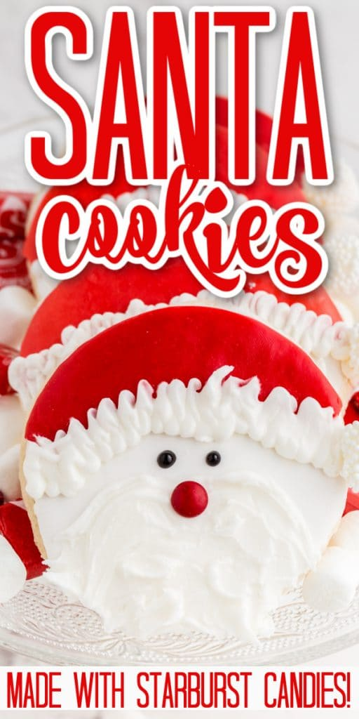 cookies decorated with candy santa face stacked on glass plate