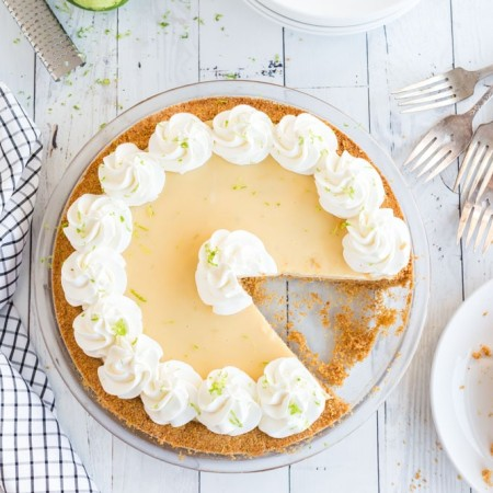key lime pie with slice removed