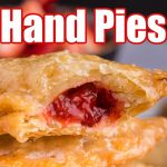 Stack of Strawberry Rhubarb Hand Pies with filling showing, text overlay,