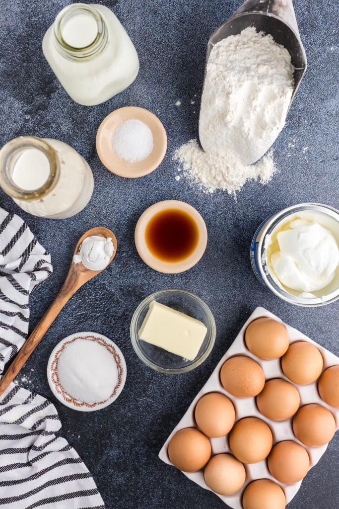individual ingredients for funnel cakes - flour, eggs, butter, milk, vanilla, etc.