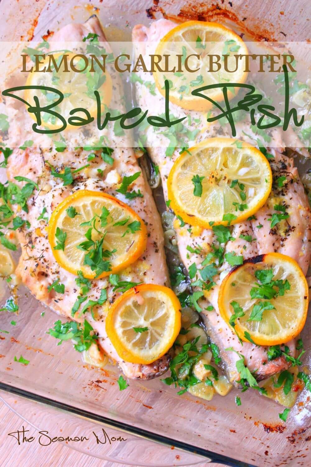 Lemon butter fish covered in lemon rounds, in a glass baking dish