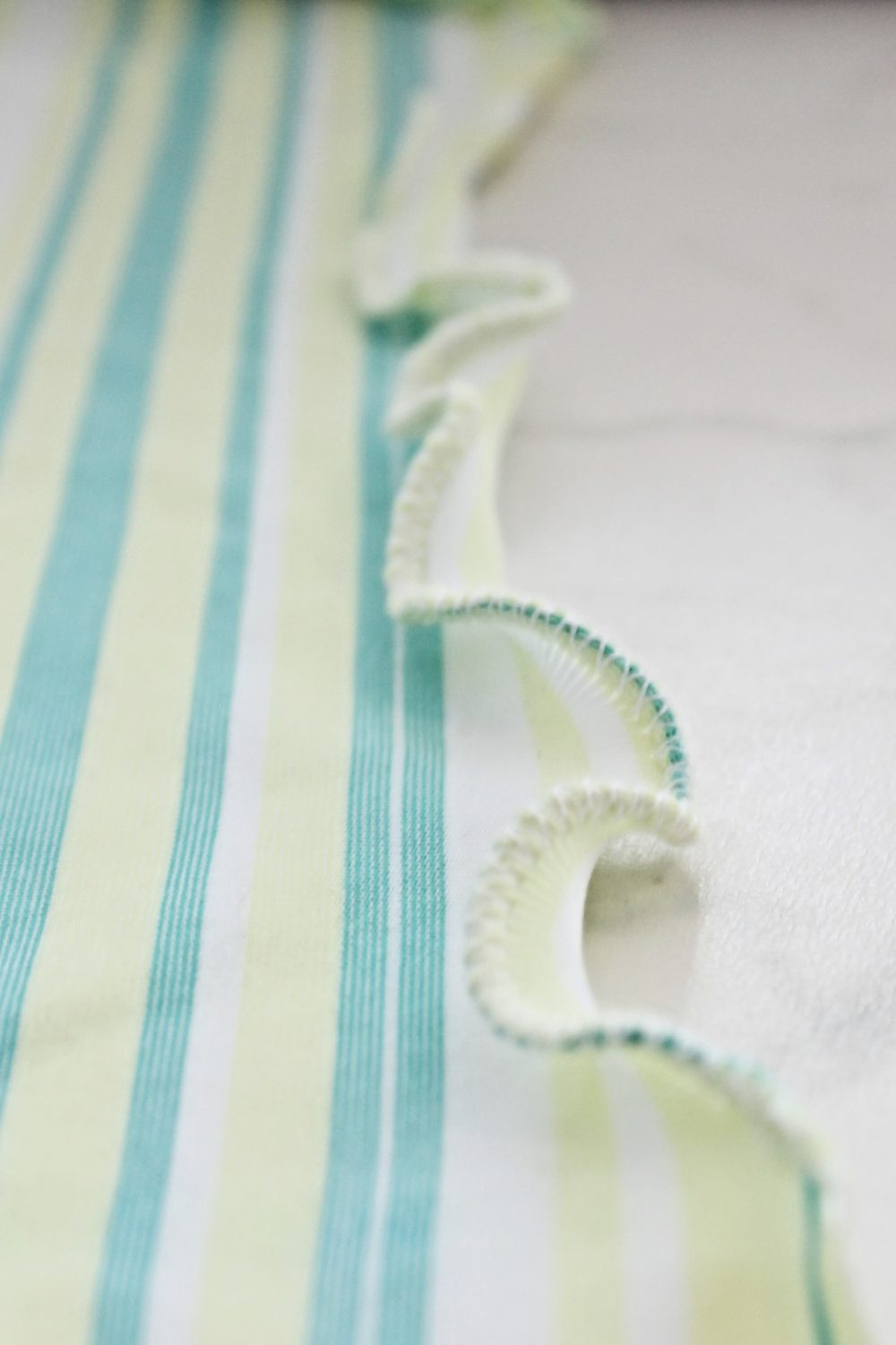 Image of a striped skirt finished with a lettuce hem