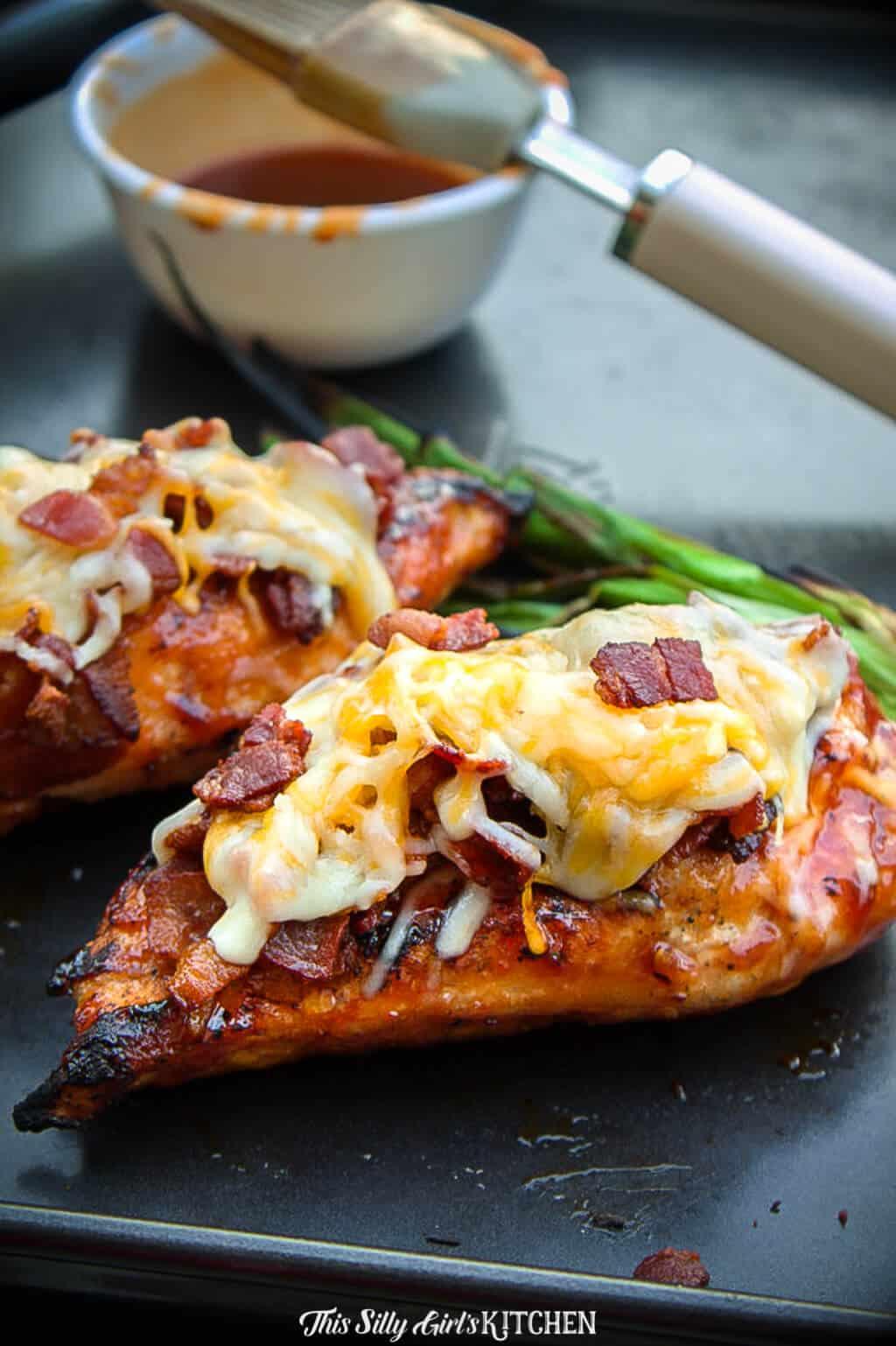 Monterey chicken, an easy grilled bbq chicken topped with BACON and melty cheese. #recipe from ThisSillyGirlsKitchen.com #montereychicken #grilledchicken #bbqchicken #chicken