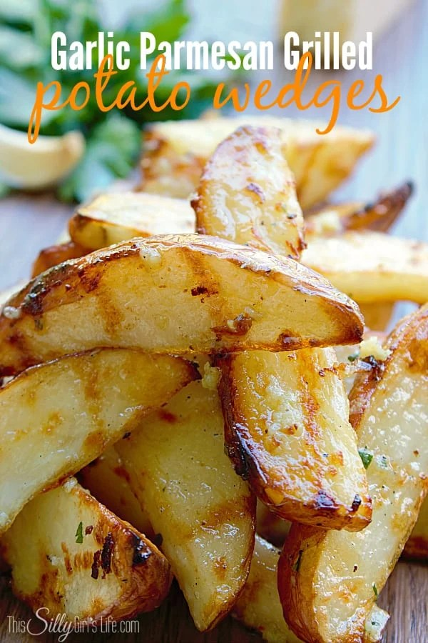 Garlic Parmesan Grilled Potato Wedges, baked then grilled and tossed in a flavorful garlic Parmesan butter sauce. Perfect for warm summer night dinners!