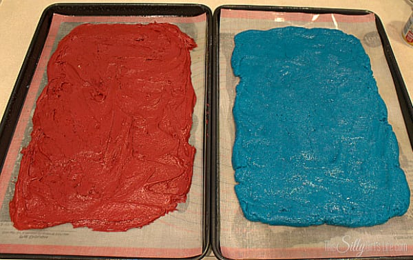 Spread each different color dough onto a parchment lined cookie sheet to 1/2 inch thick.