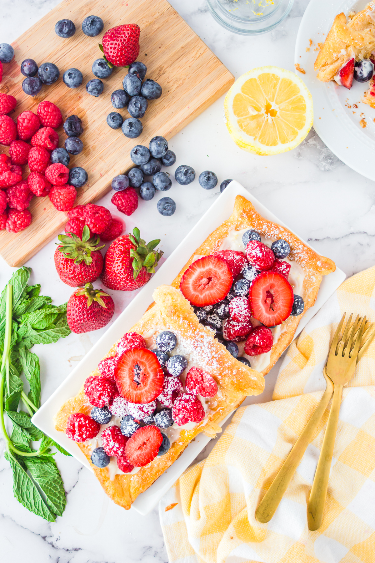 Overhead of two stacked Berry Tarts with fruit surrounding tarts