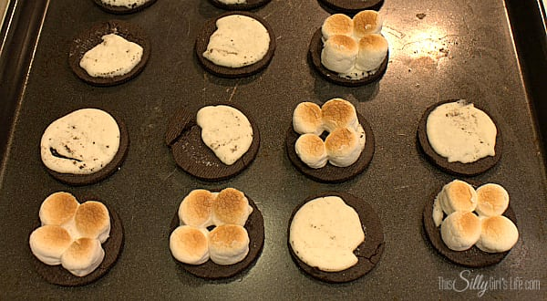 Take the oreo and carefully half them. On the side with less cream, place four mini marshmallows. Under the broiler in the oven, toast the marshmallows watching the whole time this will take about 20 seconds. Let marshmallows cool and place a teaspoon full of vanilla ice cream on top of marshmallows. Top with other half of oreo and very gently press down. Place in the freezer for 30 minutes to set up.