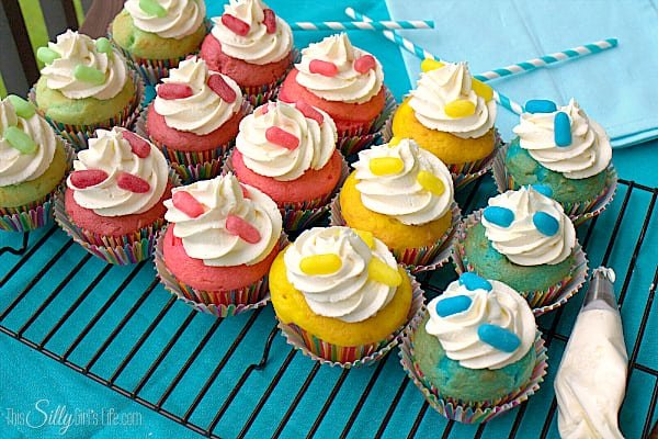 Sweet and Sour Cupcakes, colorful vanilla cupcakes, topped with light and fluffy vanilla buttercream and garnished with Zours! #ZoursFace #shop