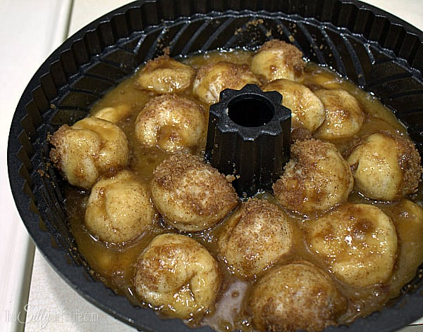 In the morning, take out the bundt pan about an hour before cooking to let it come to room temperature. Make the glaze by placing the butter and brown sugar in a sauce pot and bring to a boil, whisking constantly. As soon as it comes to a boil, pour evenly over biscuits.