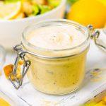 Square image of open jar of Homemade Caesar Salad Dressing.