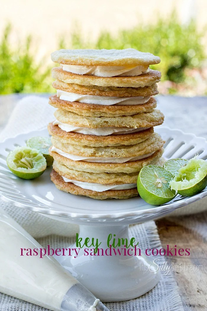 Key Lime Raspberry Sandwich Cookies, raspberry curd and key lime frosting sandwiched between two soft and chewy sugar cookies! Plus video tutorial. - ThisSillyGirlsLife.com #chewysugarcookies #sandwichcookies #keylime #raspberry