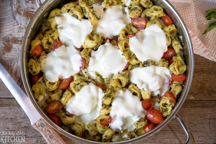 30 Minute One Pot Caprese Tortellini Bake, have dinner on the table in 30 minutes with this epic baked pasta dish! from ThisSillyGirlsKitchen.com #BarillaPesto #BJsWholesale #BarillaTortellini #ad @BarillaUS