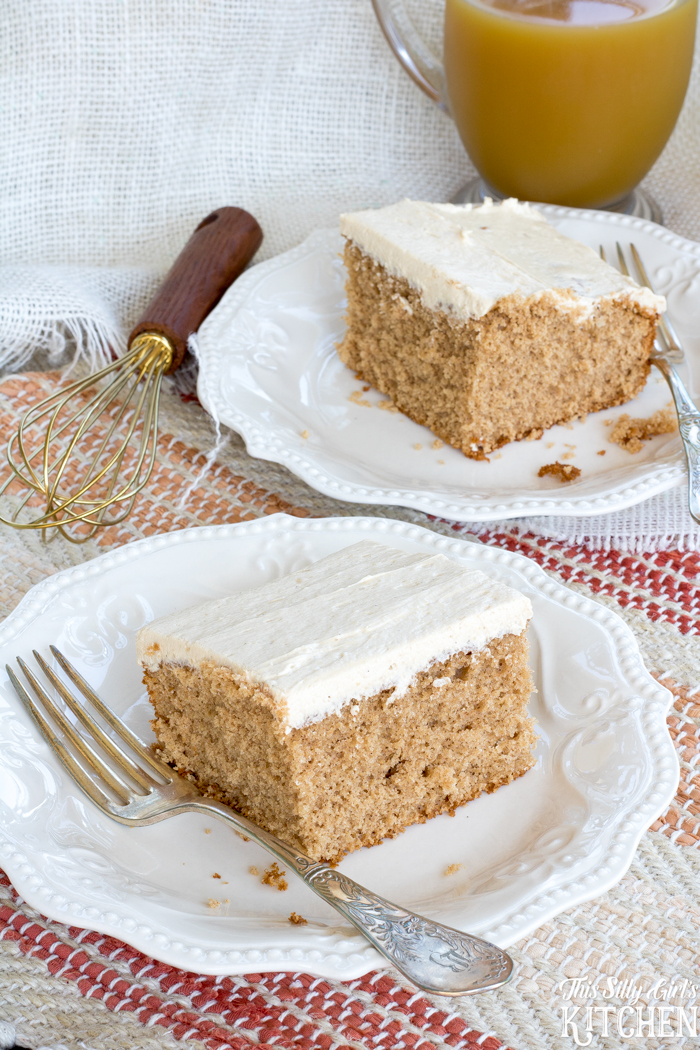 Frosted sheet cake on white plate with forks.