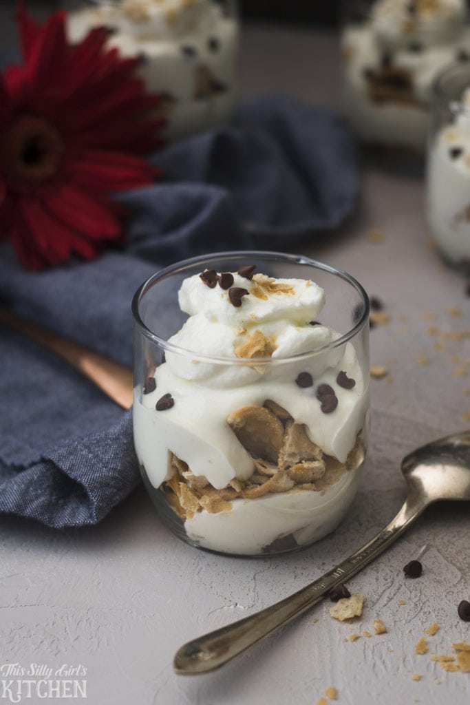 Cannoli Parfaits, sweetened ricotta and mascarpone cheese layered with crumbled cannoli shells and mini chocolate chips! Recipe from ThisSillyGirlsKitchen.com