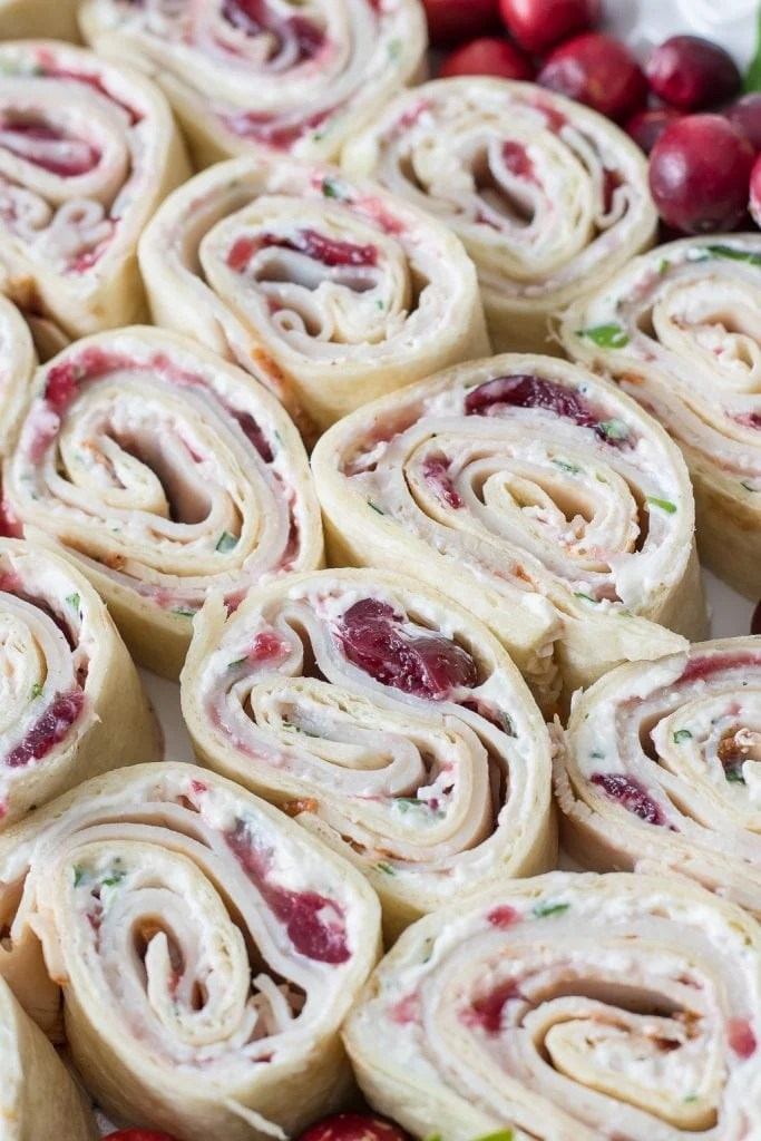 Close up of Cranberry Turkey Pinwheels on serving tray