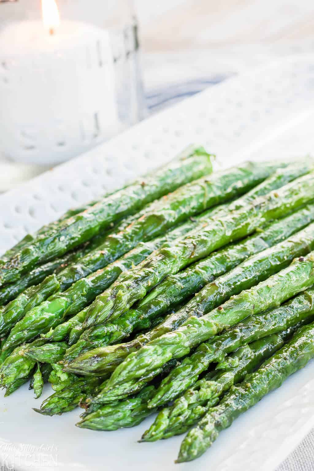 Grilled Asparagus, made with 5 simple ingredients and ready in under 15 minutes! #Recipe from ThisSillyGirlsKitchen.com #asparagus #grilledasparagus