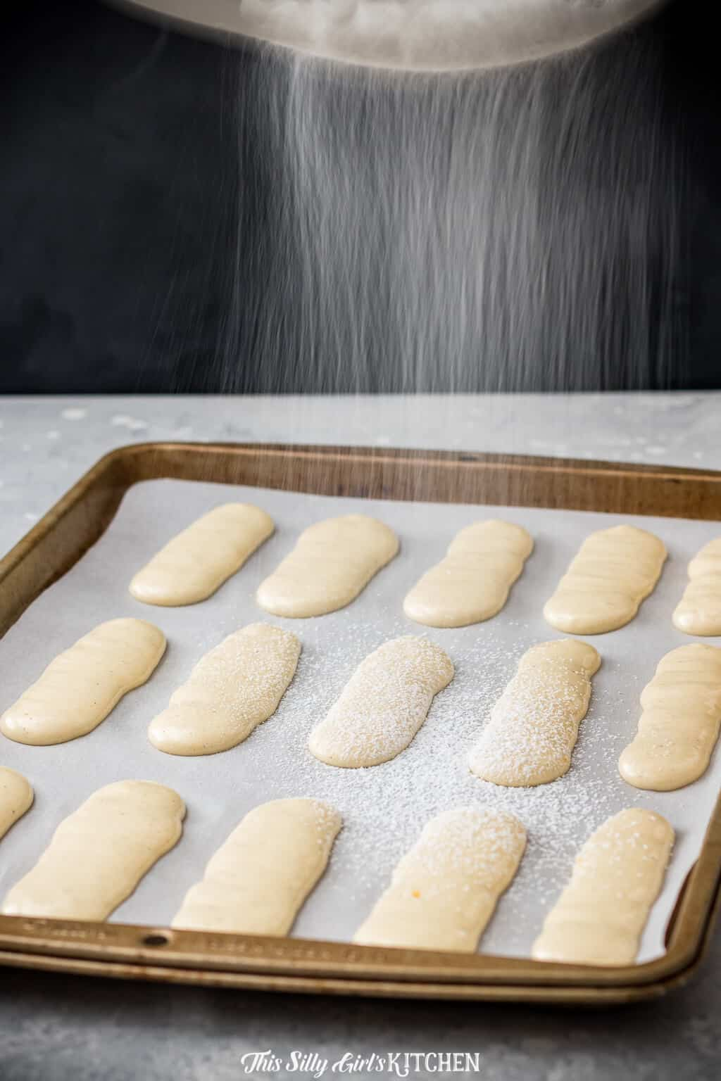 Ladyfinger cookies are light, crunchy cookies with a subtle sweetness. #Recipe from ThisSillyGirlsKitchen.com #ladyfinger #tiramisu #cookie #ladyfingersdessert