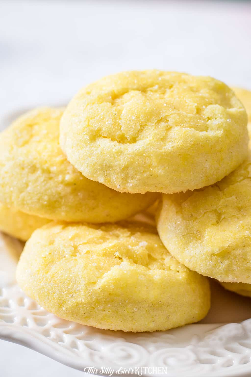 Close up of Lemon Cookies stacked on white plate