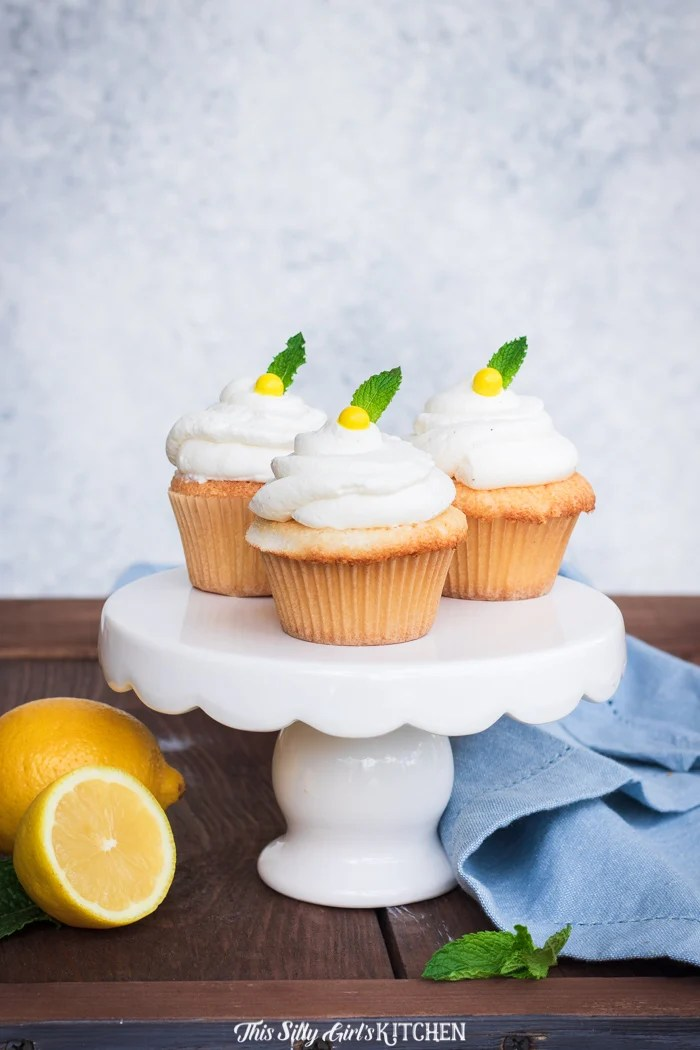 Epic Lemon Cupcakes - Lemon curd stuffed in an angel food cupcake and topped with lemon whipped cream frosting #recipe from thissillygirlskitchen.com #lemoncupcakes #lemonycupcakes #angelfoodcake #angelfoodcupcakes #lemoncurd #whippedcreamfrosting