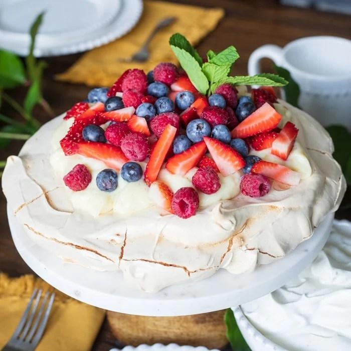 Berry Pavlova recipe on cake stand square image