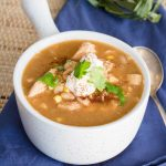 White Chicken Chili in white bowl close up square image