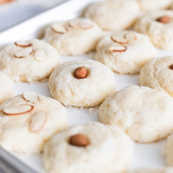 Almond Cookies on baking sheet close up square image