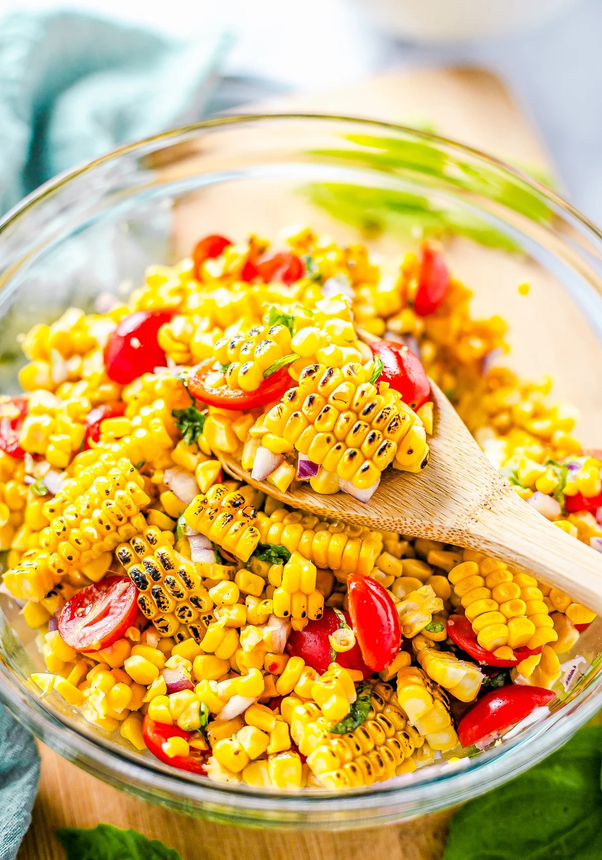 Spoon holding up some Corn and Tomato Salad
