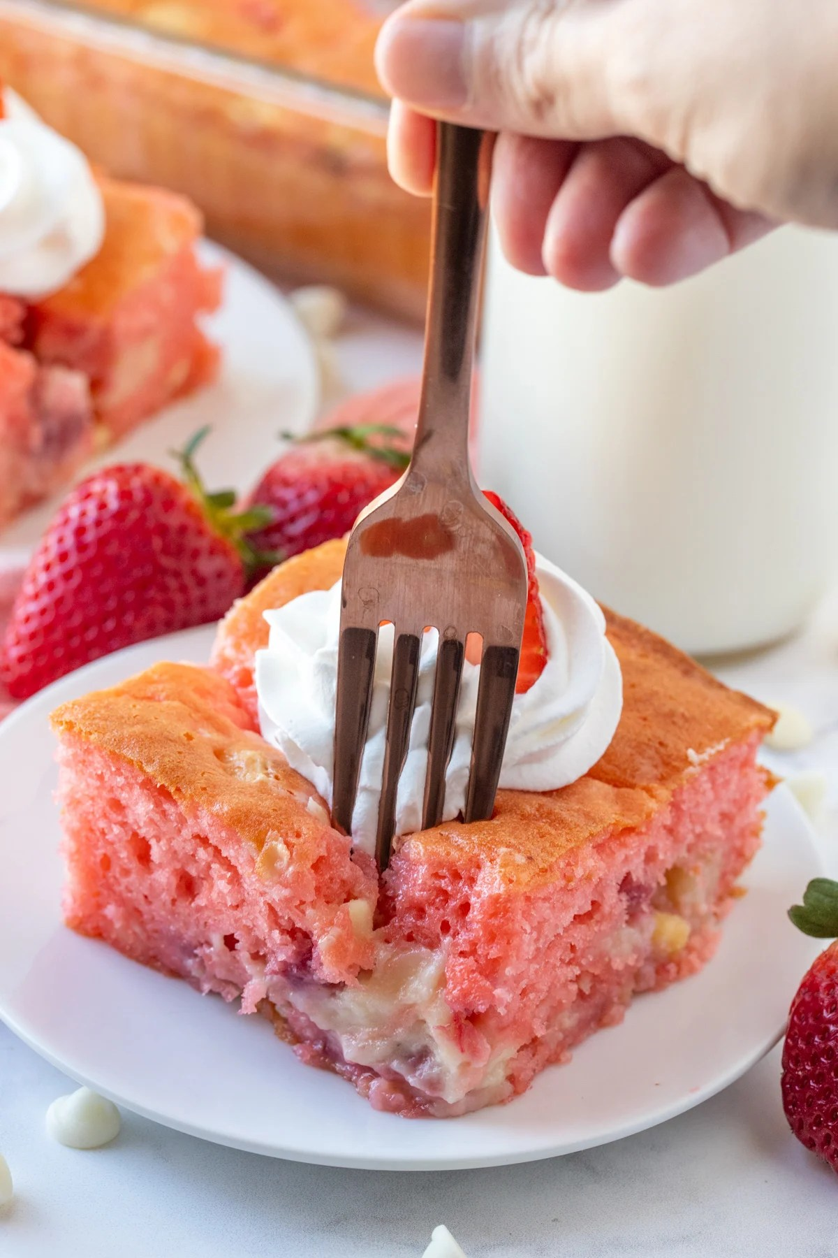 Fork going into slice of Strawberry Earthquake Cake