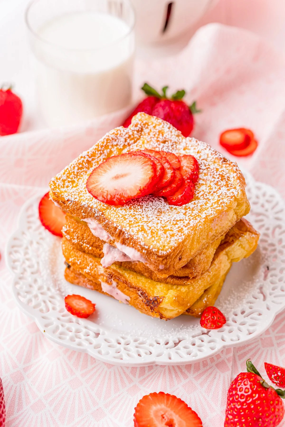 Strawberry Cheesecake Stuffed French Toast on white plate stacked