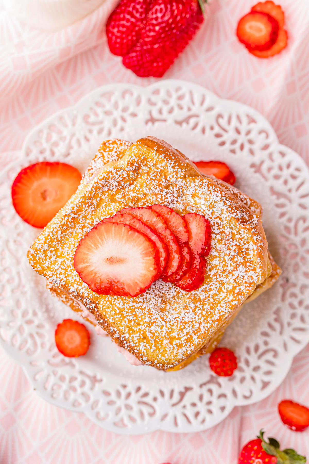 Overhead of French Toast on plate garnished with strawberries