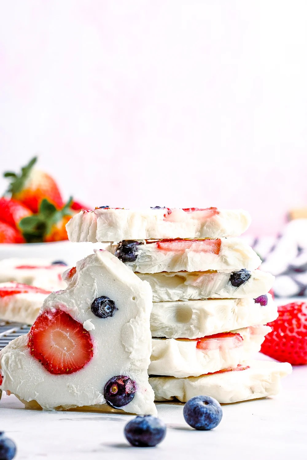 Stacked Yogurt Bark surrounded by fruit