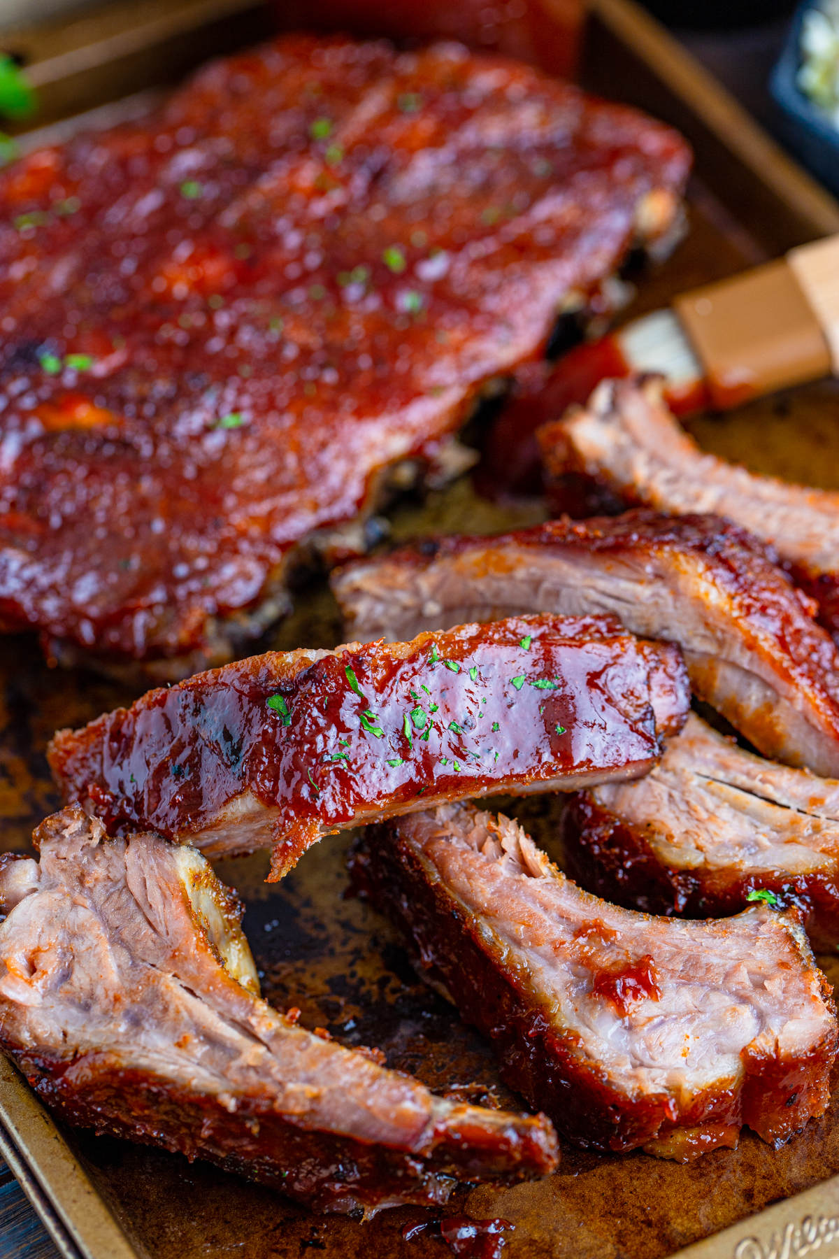 Slow Cooker Ribs on baking sheet cut into sections
