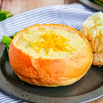 Square image of soup in bread bowl.