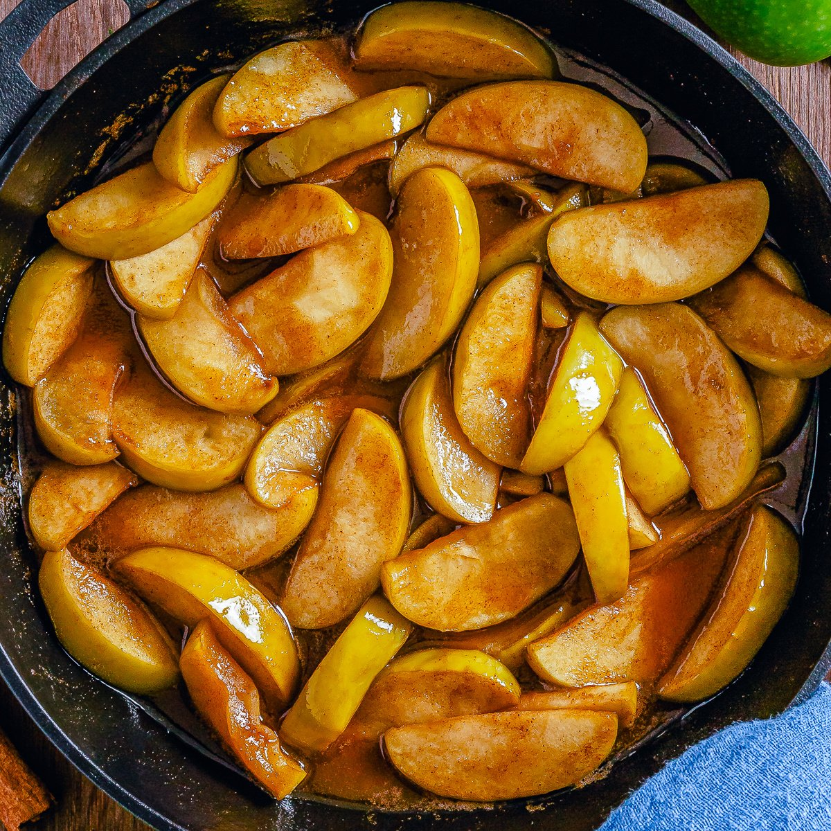 Square photo overhead of Fried Apples in skillet.