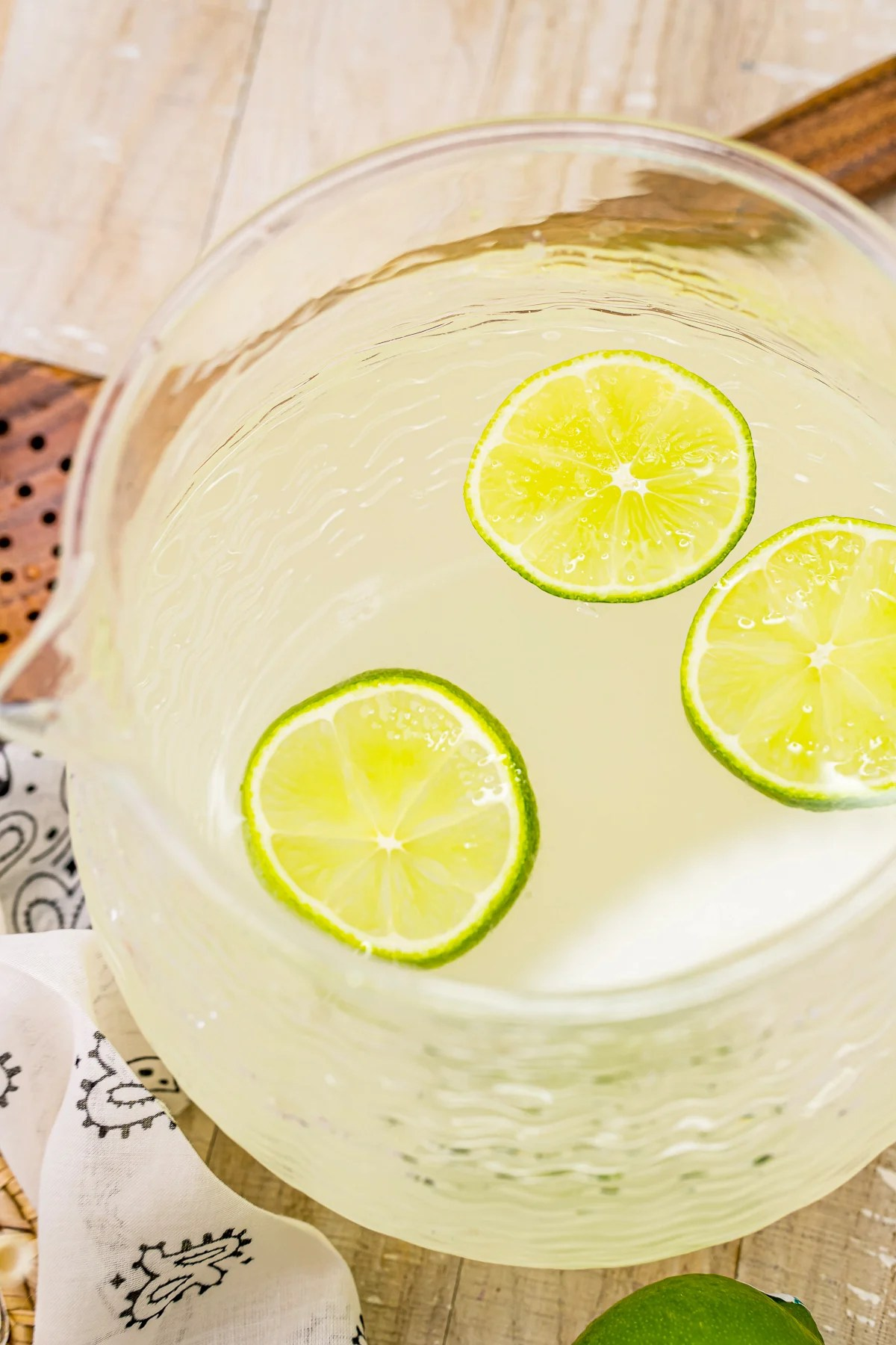 Overhead pitcher of the Limeade Recipe with slices of lime