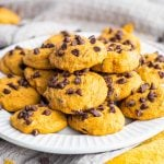 Square image of Pumpkin Chocolate Chip Cookies on white plate.