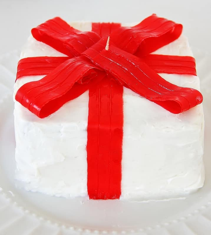 Add folded strips to cake to create the bow
