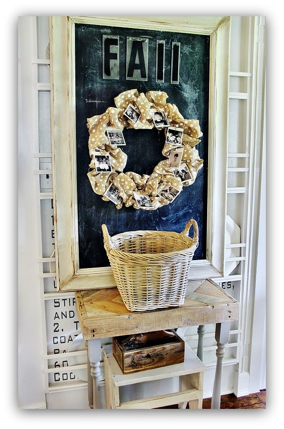 """This board featuring a """"fall"""" sign and decorative wreath are adorable."""