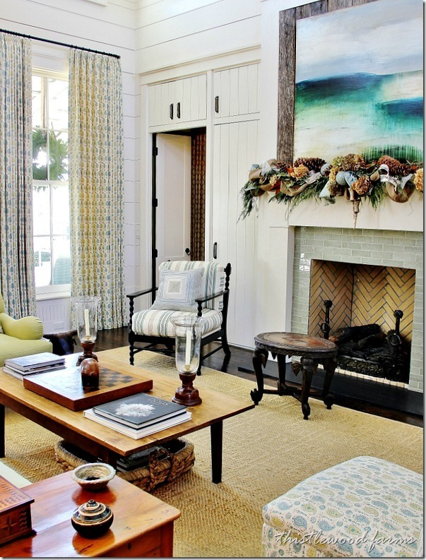Built in cabinets above the doorways add extra storage to this lovely living room scene