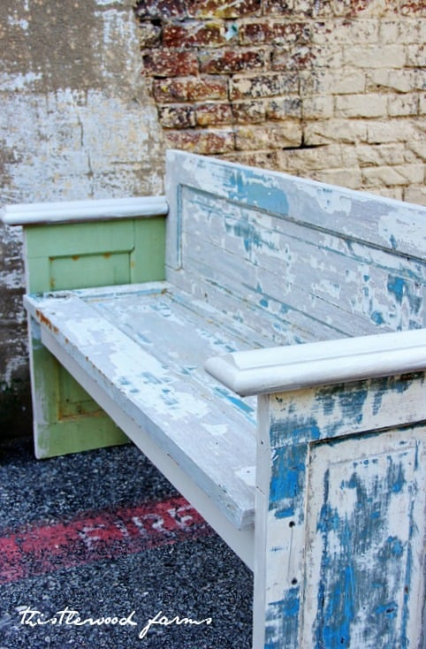 A rustic farmhouse bench made from an old door
