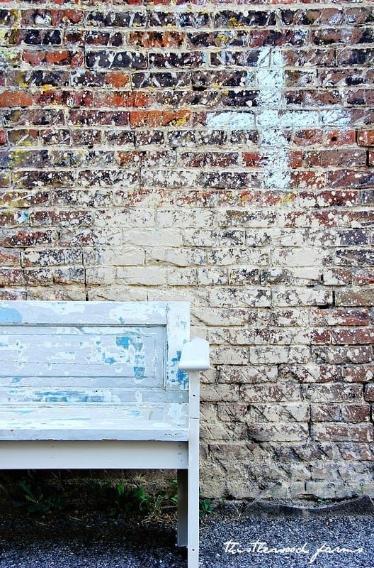 Chipped paint and weather-worn wood makes this DIY bench a gorgeous project and addition to your home