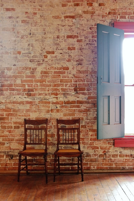 Wooden Chairs with Brick Wall