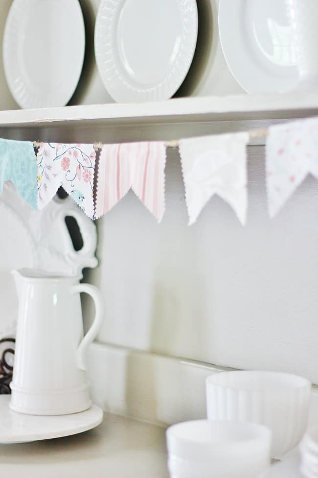 Fabric pennant banner made with a charm pack