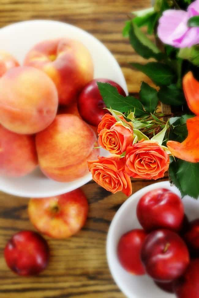 four roses and fruit