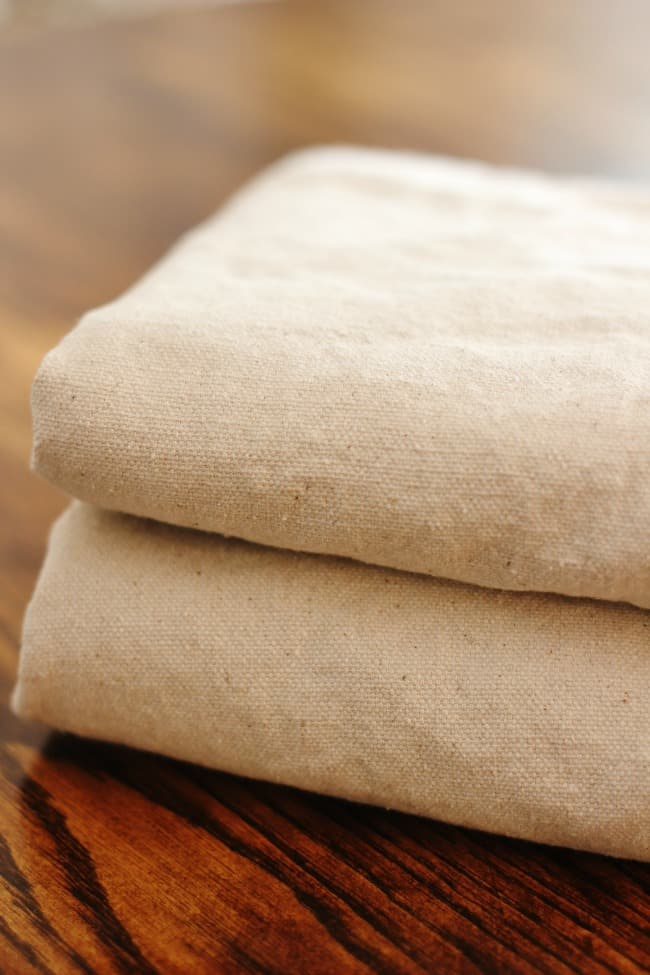 You can easily turn these simple drop clothes into amazing Roman Shades.