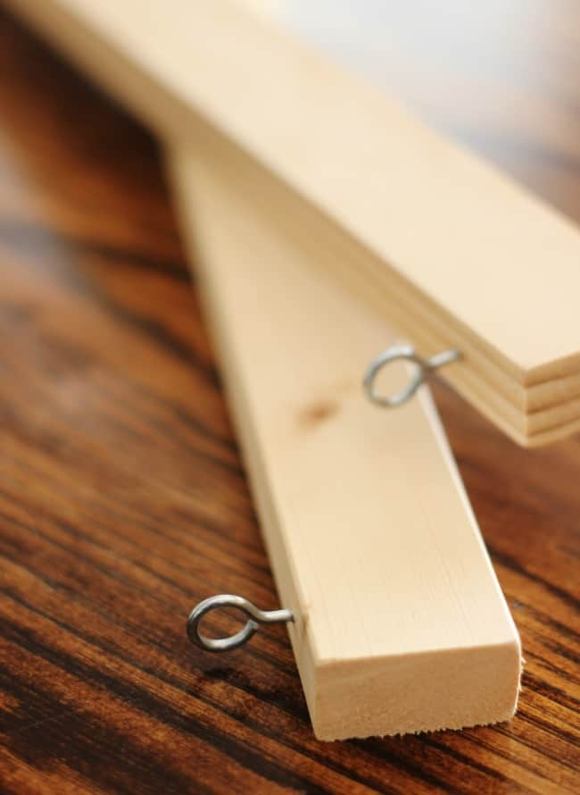 Carefully place the hooks in your boards to create your Roman Shades