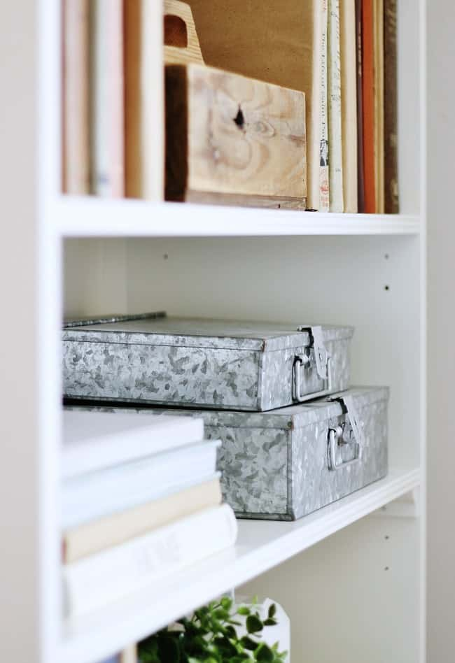 decorate your bookcase with metal tins